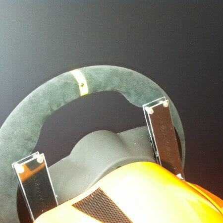 Slider mounted at the back of the steering wheel