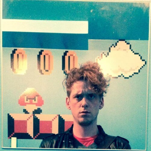 A profile image showing martin in front of a super mario wall paint