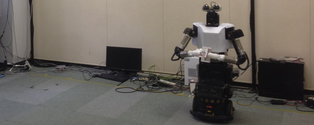Flyer distribution robot searching for humans. The picture was taken at ATR, Advanced Telecommunications Research Institute, Japan